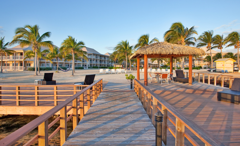 on site beach and pier at grand caymanian resort
